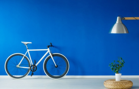 81726301 - black and white bicycle standing in a blue living room